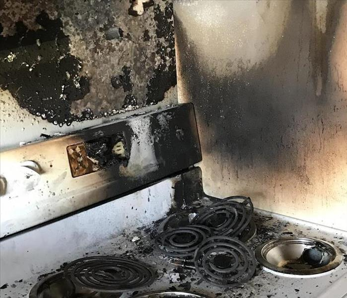 stove and wall charred by fire